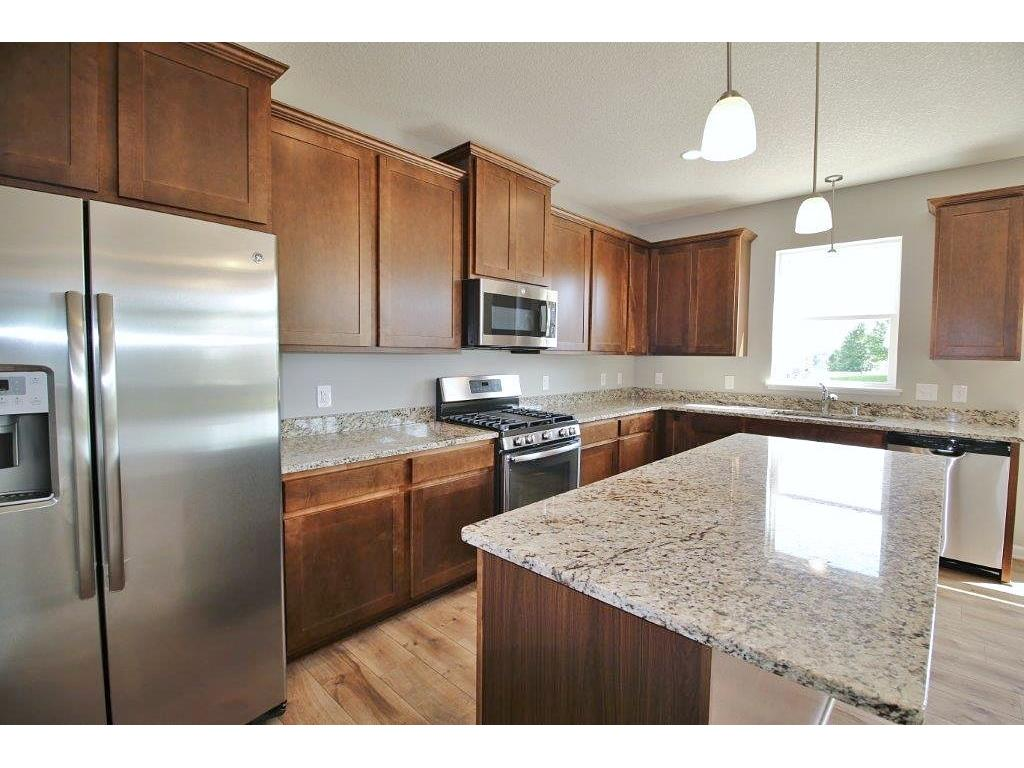 The large designated Kitchen Island captures a nice focal point in this spacious kitchen.