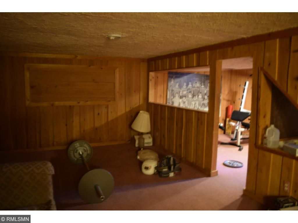 Lower level family room.  Cedar wall boards.  More closet space too.
