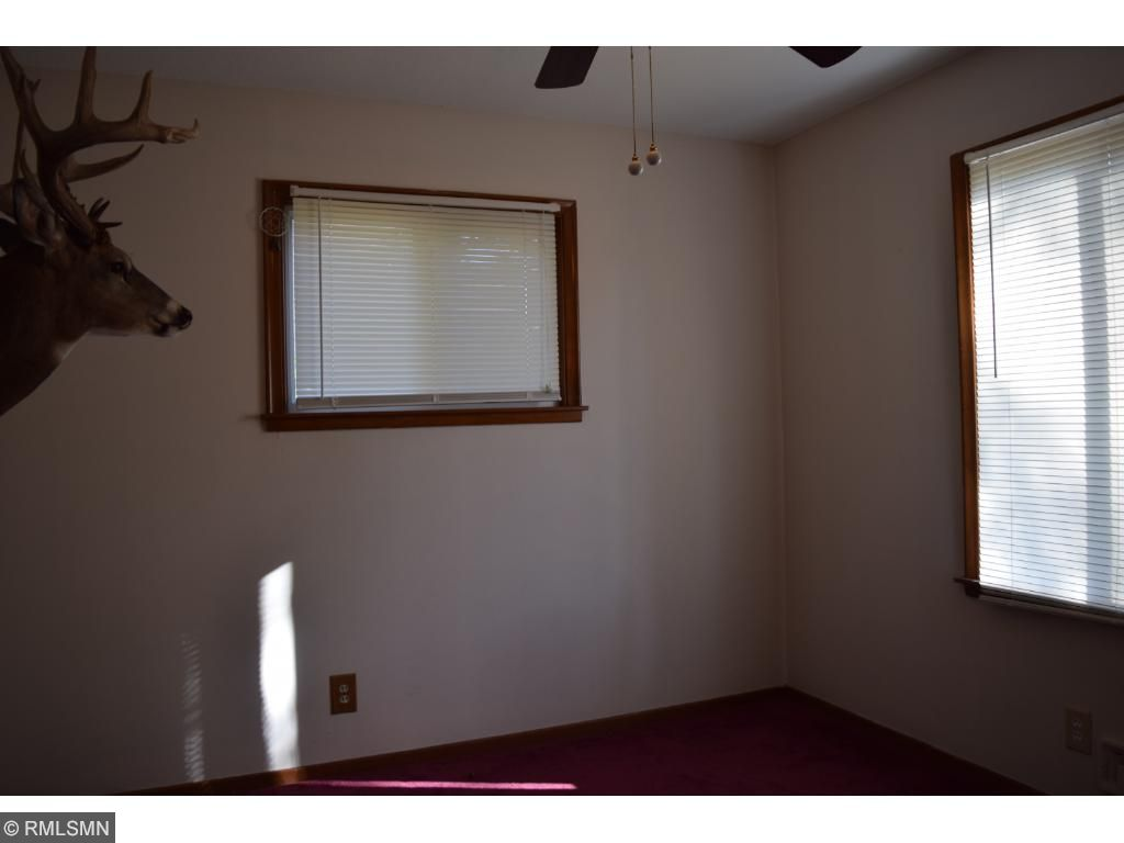 Main level bedroom with updated ceiling fan/light.
