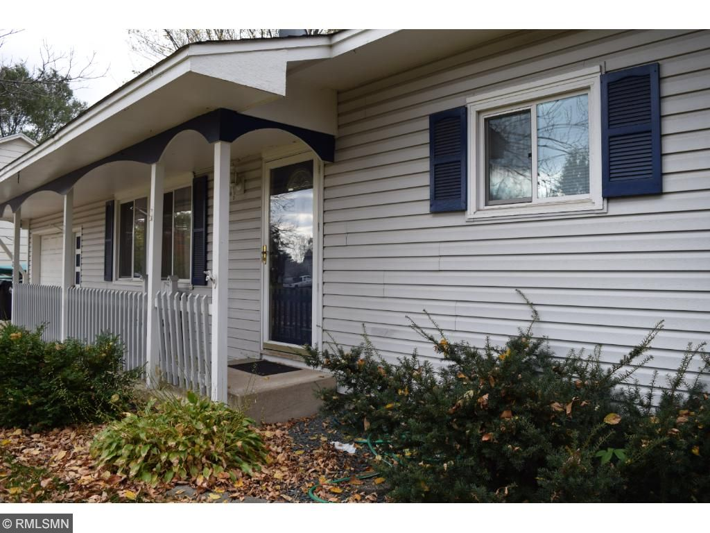 Vinyl siding and shutters.  Large living room windows provide ample lighting.