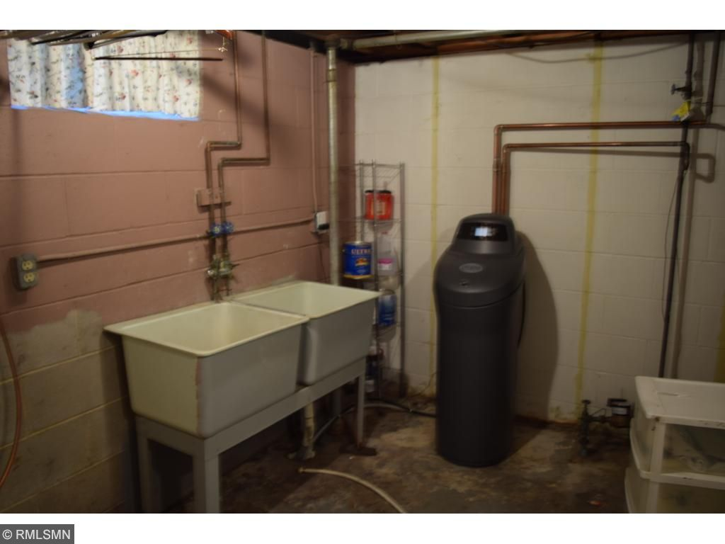 Laundry room with new 2014 water softener.