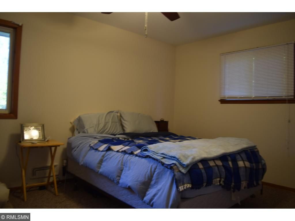 Master bedroom with ceiling fan/light.