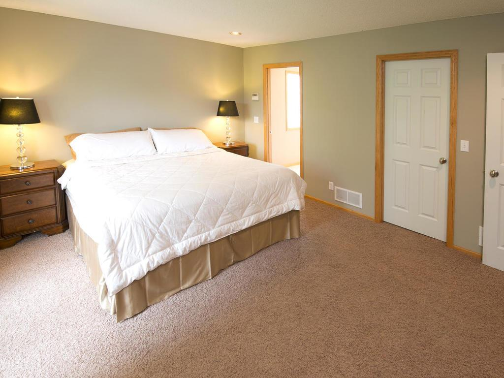 Spacious master suite has lovely natural light while maintaining great privacy from mature trees out front. Enjoy a large walk-in closet as well as private master bathroom.