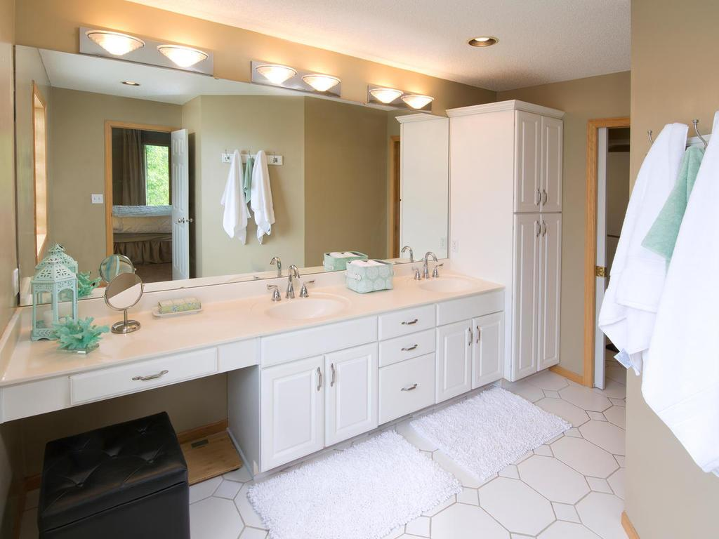 Master bathroom equipped with dual sinks and plentiful counter space for all your needs. Tile floors and extra cabinetry for storage. Great natural light beams throughout. Private toilet room. Time to relax and enjoy your very own steam shower.