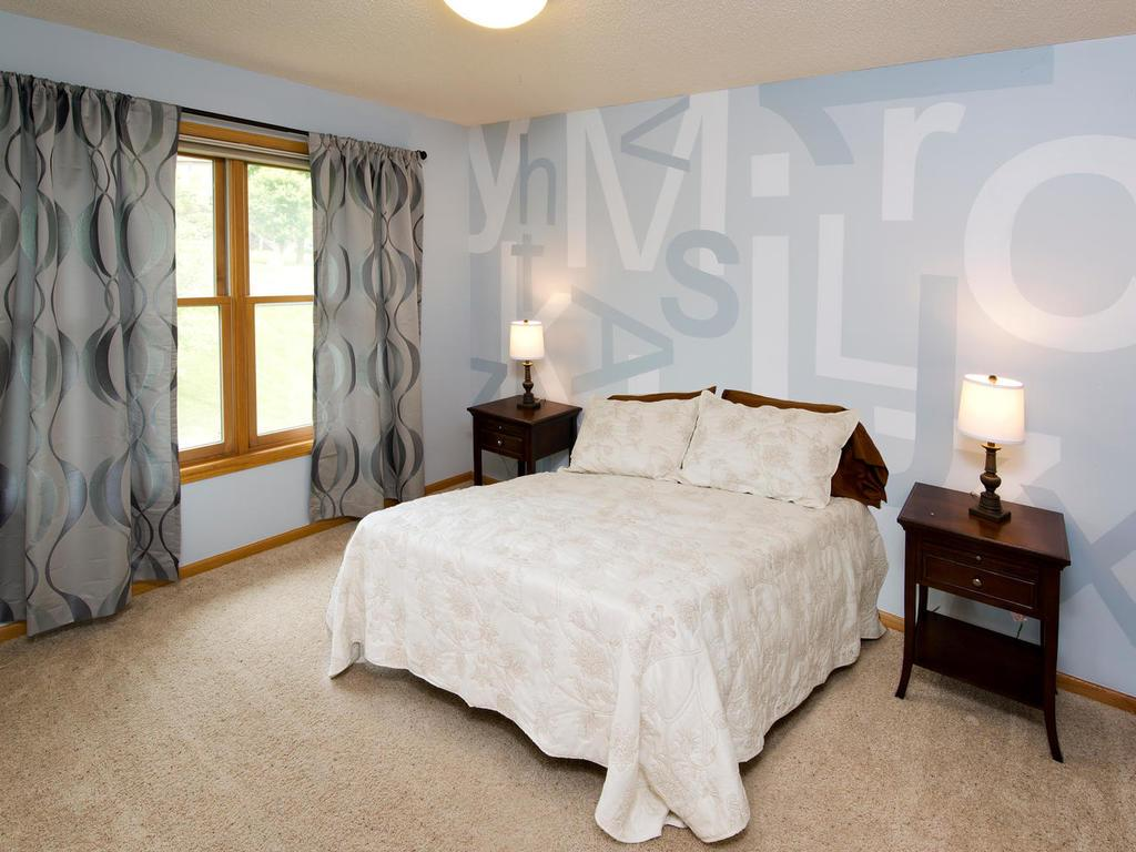 Three bedrooms on upper level. Beyond the master are two generous sized bedrooms. Bedrooms are located near upper level full bathroom with a jetted tub.