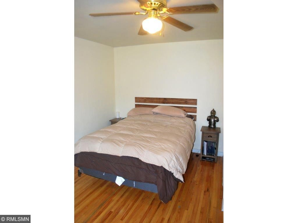 Main level bedroom with hardwood floors
