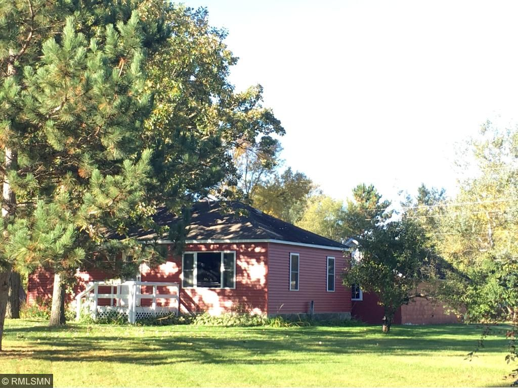 Front of home with monster Oak tree view in Fall