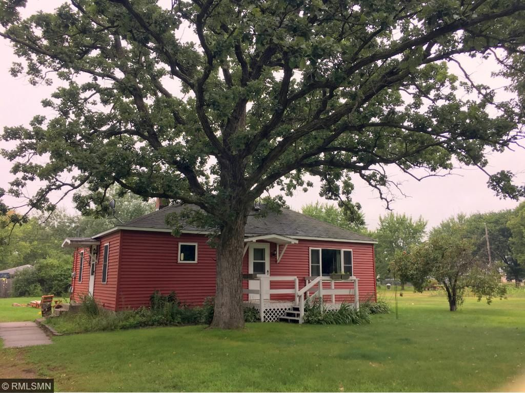 Front of home with monster Oak tree
