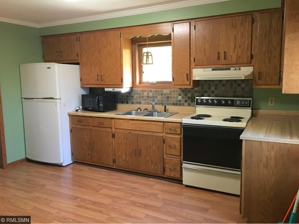 Kitchen has updated backsplash and flooring