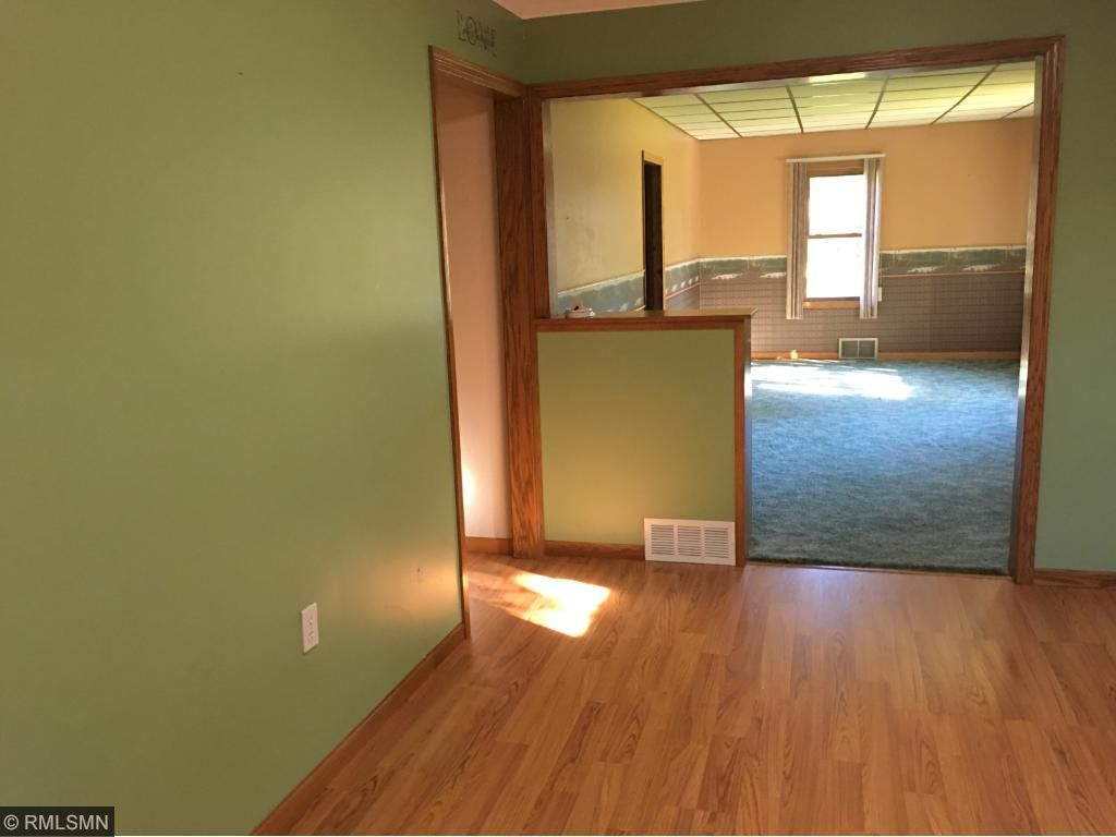 Dining area in kitchen with newer flooring
