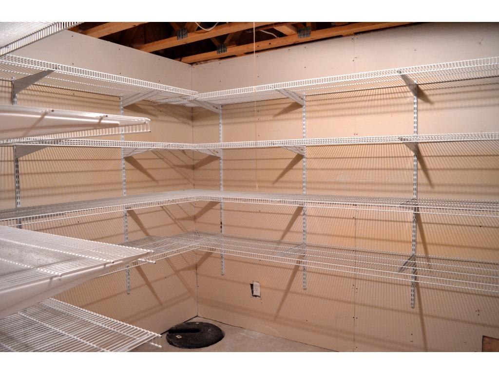 Need additional storage space? No problem! The lower level has ample room to store away boxes and keepsakes.