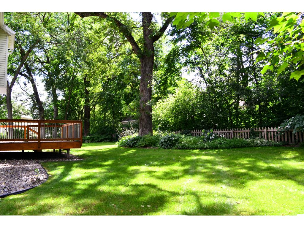 Artfully landscaped, the yard offers an abundance of perennials, a private garden and plenty of shade.