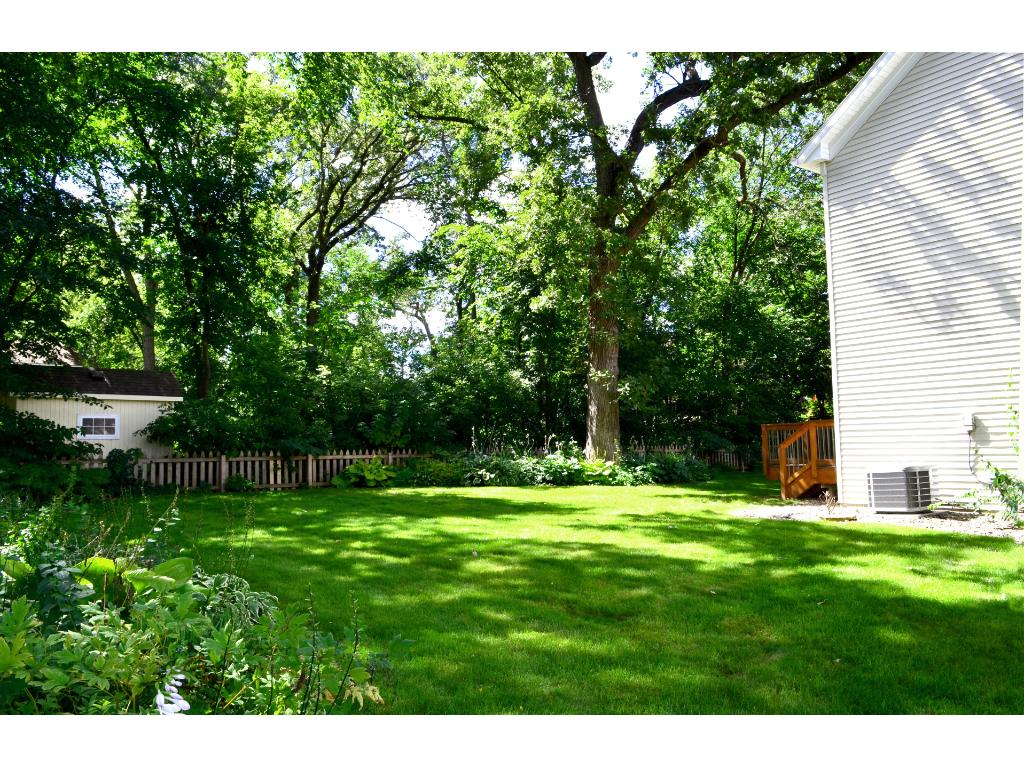 Another view of the backyard shows you how generous and beautiful the green space is around the home.
