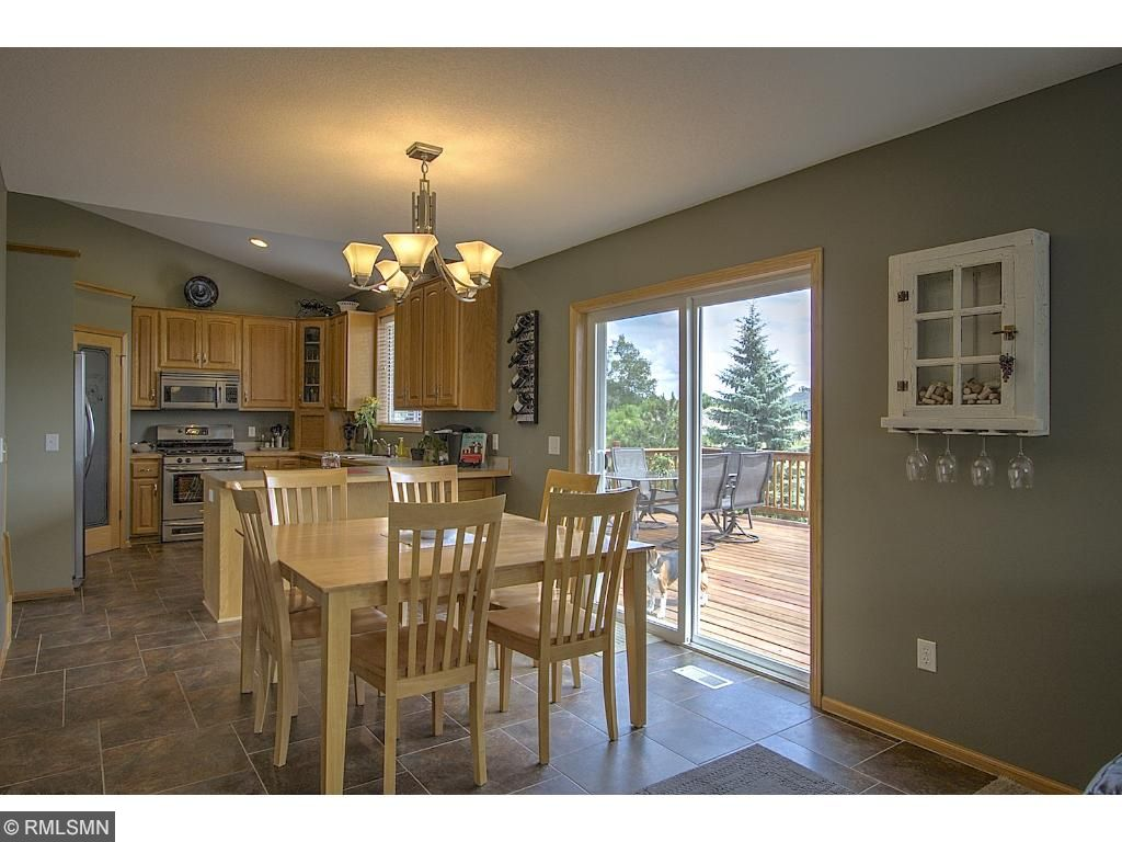 Large dining area with deck access.