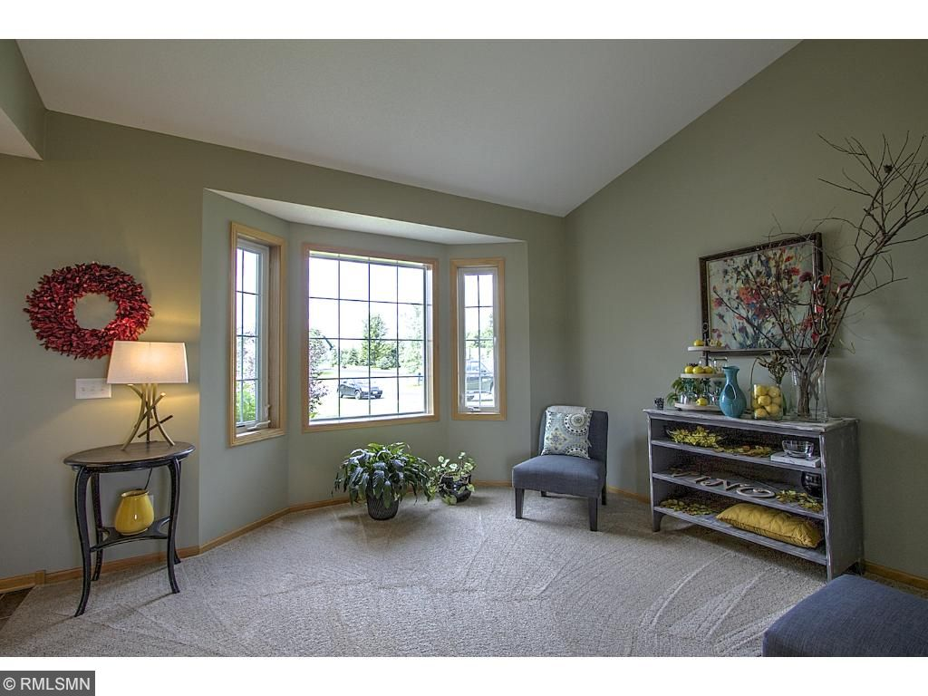 Formal sitting room with bright natural light.