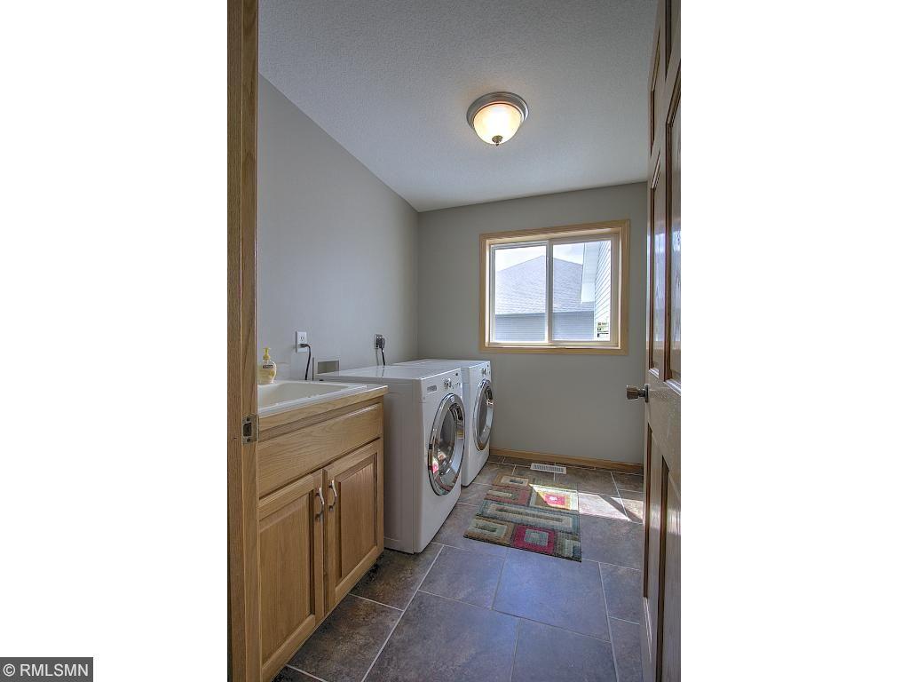 Main floor laundry with ceramic tile floors.