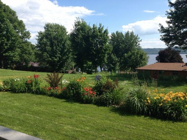 Summer backyard flowers are beautiful, as is the view of Lake Pepin.