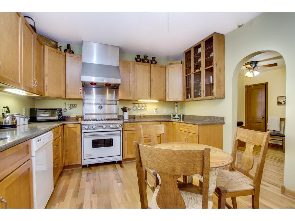 Wonderful, large eat in kitchen with top of the line appliances, quartz counter tops by Cambria, wood floors and a window above the sink that overlooks your private backyard. Lots and lots of counter space and cabinets.
