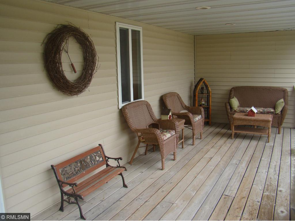 Sit a spell on the large covered porch.