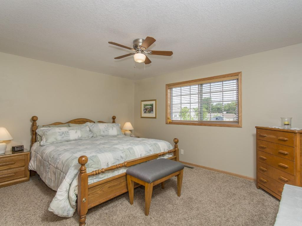 the roomy master bedroom features a walk in closet and a handy walk thru full bath.
