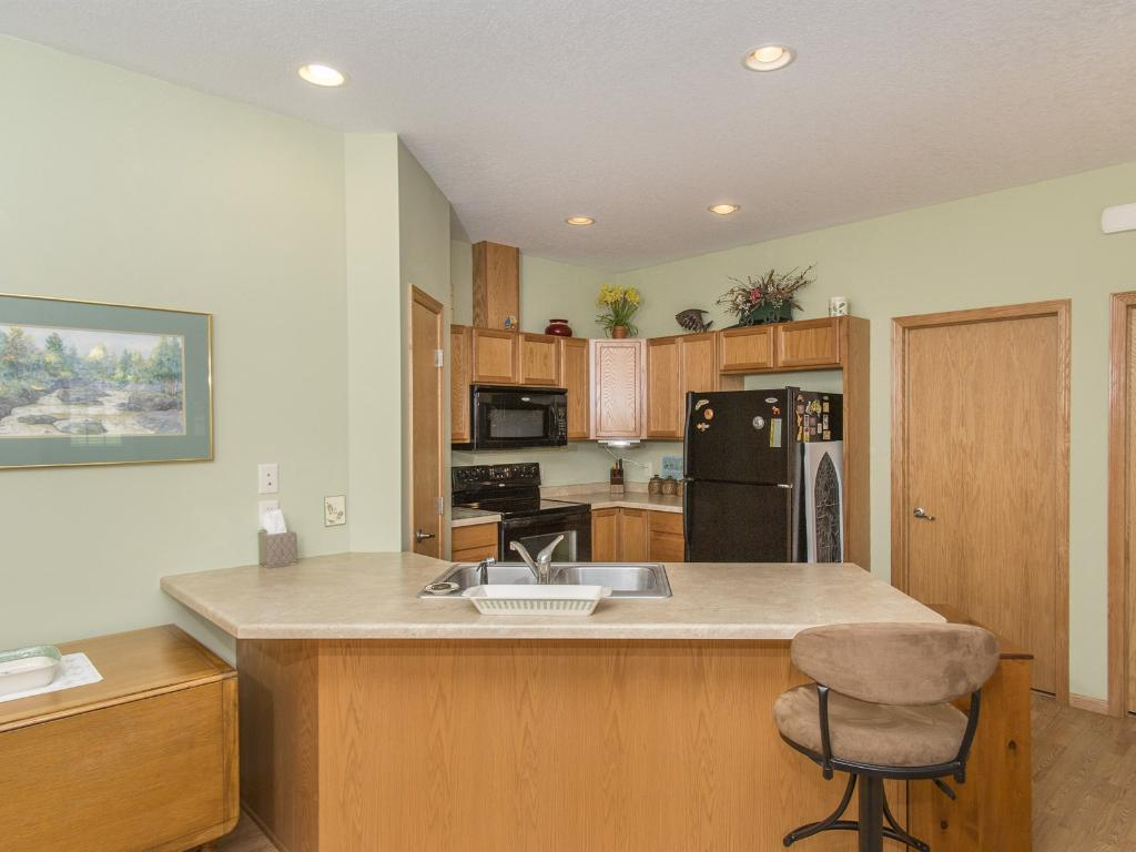 The efficient kitchen has a  handy breakfast snack bar, all appliances, plenty of cabinets with a pantry for extra storage.