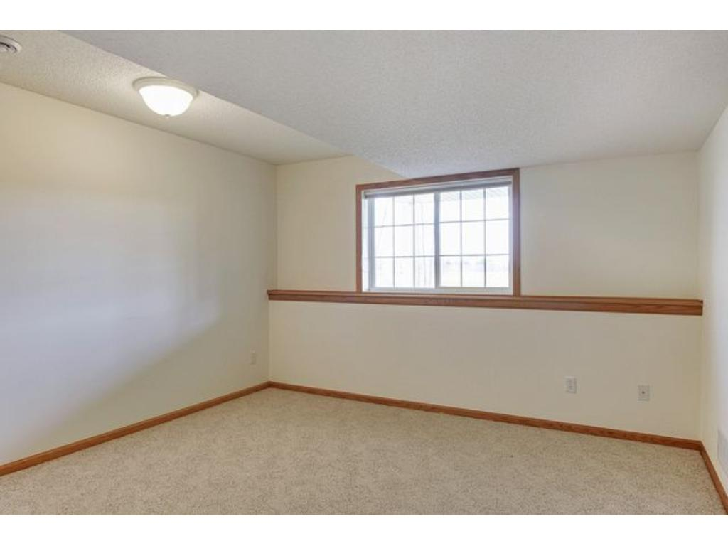 Spacious lower level bedroom with ample natural light.