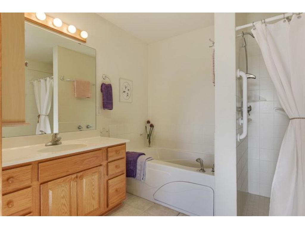 Full master bath with jetted tub, separate walk in shower and in floor heat.  This bath is handicap accessible.