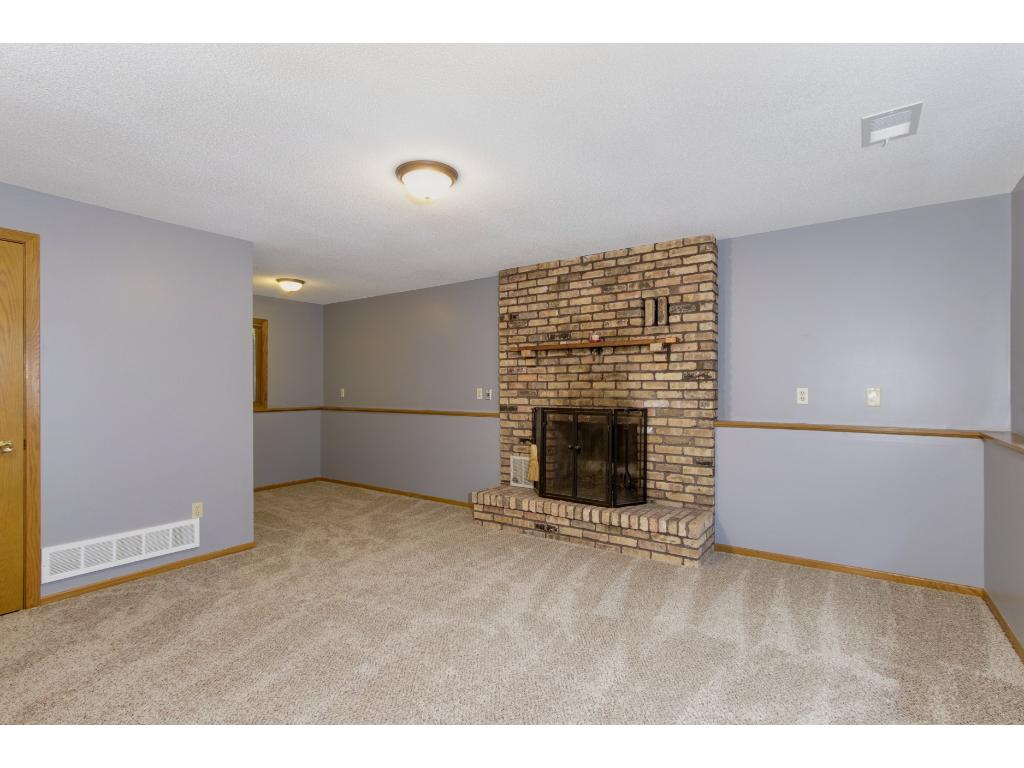 Second Wood Burning Fireplace in generously sized lower level family room