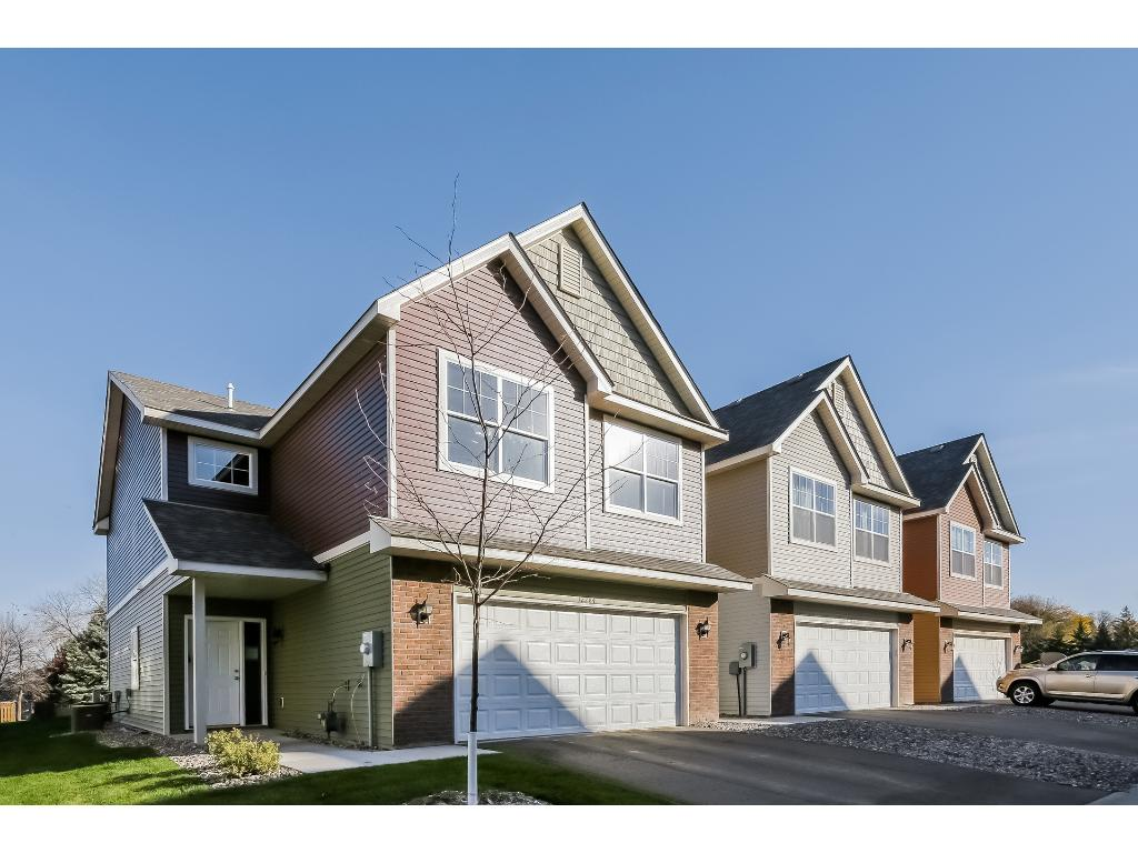 Picture is of the exterior of model home at 12284 River Valley Drive, Burnsville, MN 55337.