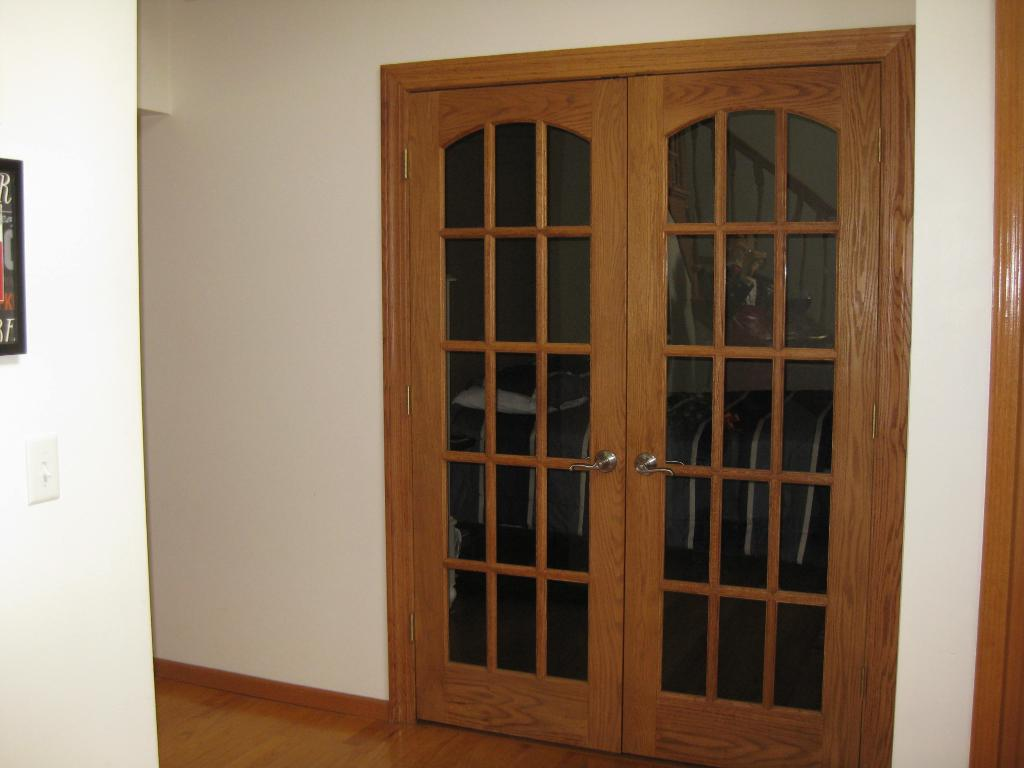 French doors to Formal Dining room. (Has been made into bedroom for seller due to surgery.)