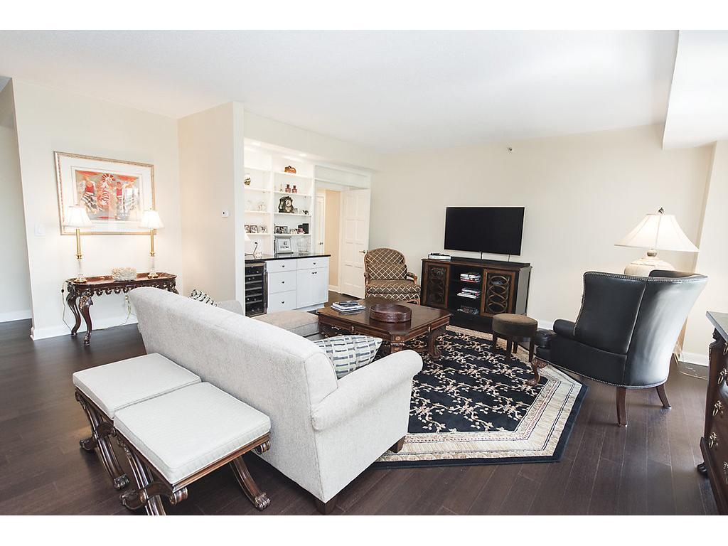 White trim, dark custom flooring, open floor plan concept and more!