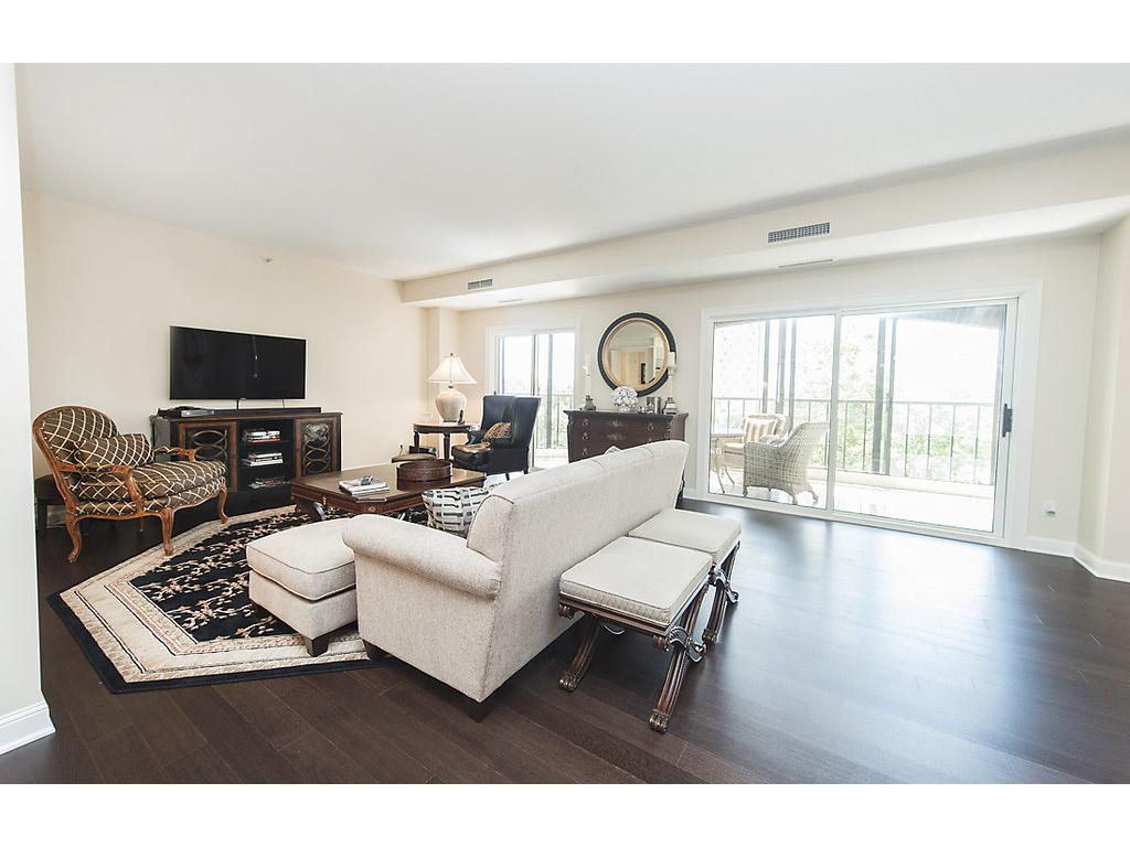 Lovely family area with panoramic views and a walk out to the screened in porch!