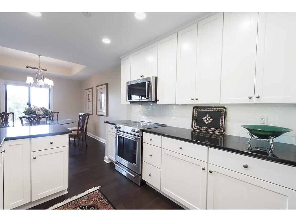 Fully remodeled custom kitchen - stone countertops, plenty of cabinets, 20K worth of new appliances, open and spacious - truly for the gourmet!