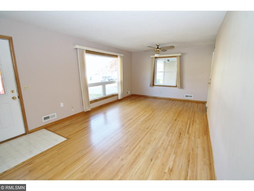 Open front living room has gleaming oak flooring...