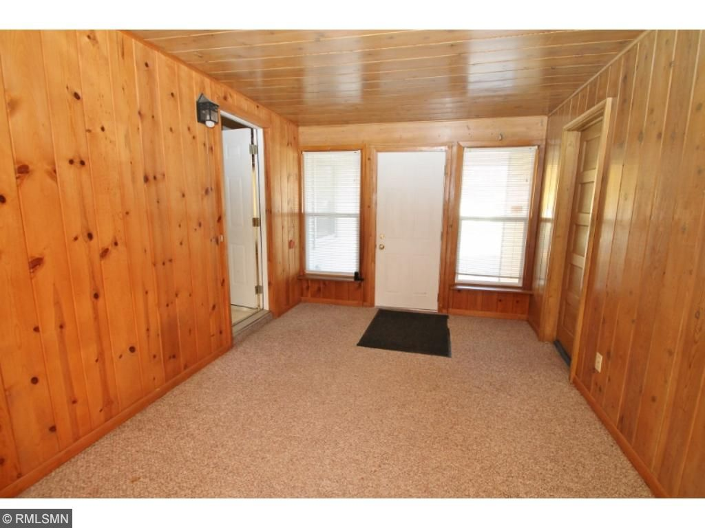 Knotty pine breezeway to Kit, Garage and family room...