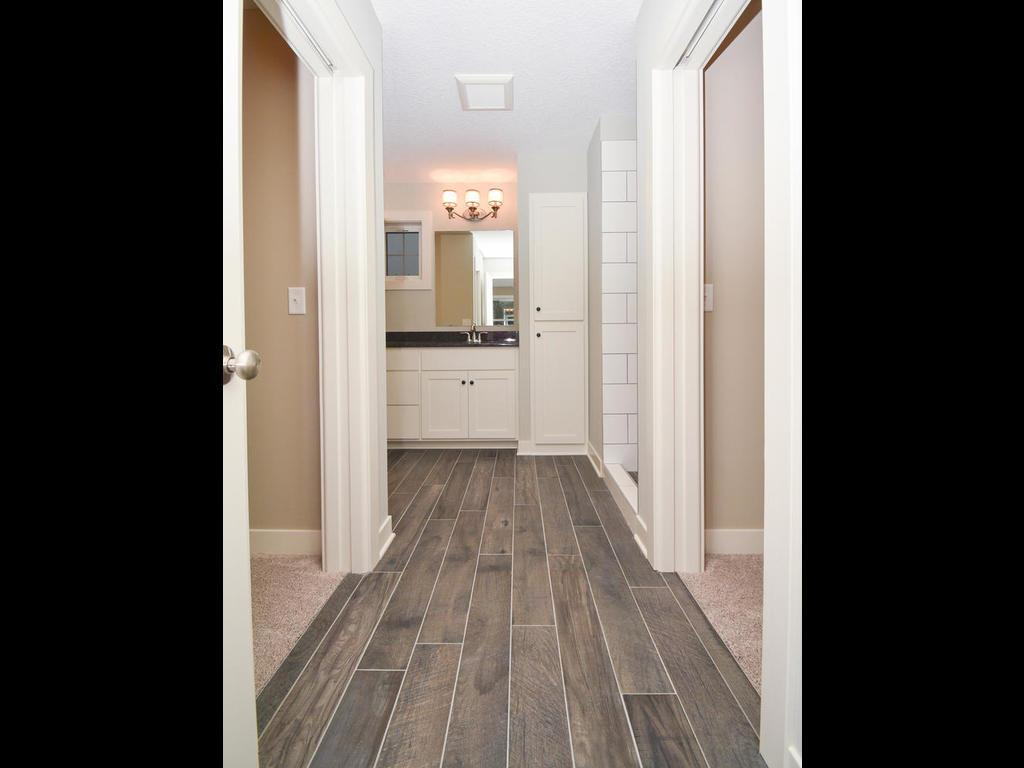 His/Hers closets into the master bathroom