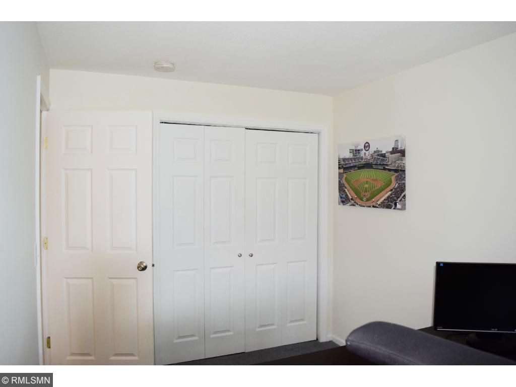 Lower level bedroom has spacious closet.