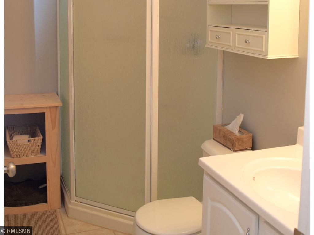 One of three bathrooms -- one full on the upper level, a convenient powder room on the main level and a 3/4 bathroom on the lower level.