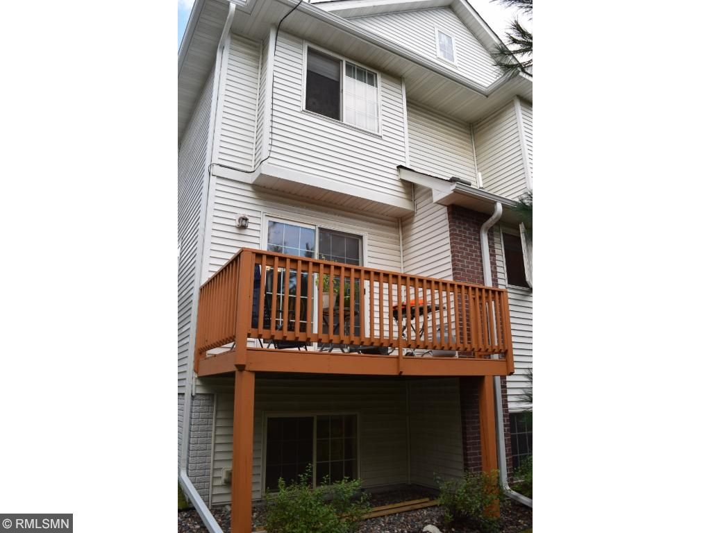 Perfect gathering spot outside on the deck or the green space with walking path directly behind townhome.
