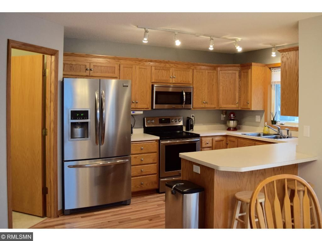 Check out this incredible kitchen with large breakfast nook, newer stainless steel appliances, newer paint and brand new flooring throughout the entire main level.