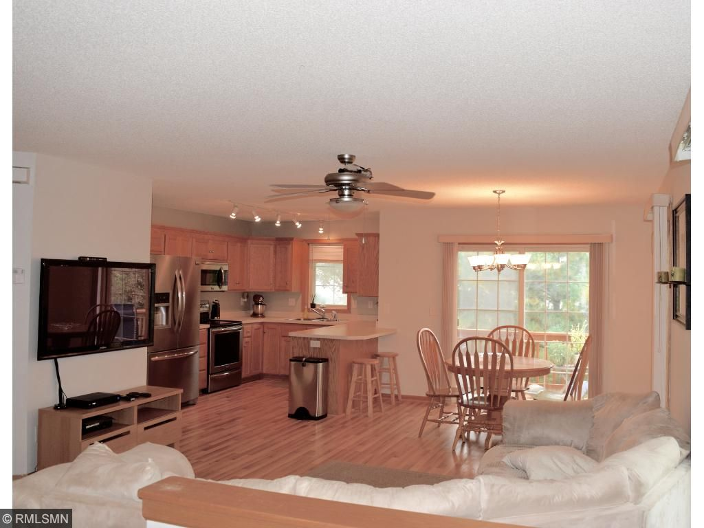 Huge main level family room is open to kitchen and dining room.