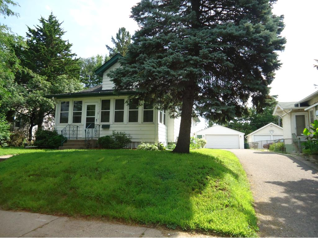 GREAT CRAFTSMAN BUNGALOW WITH LOADS OF WOODWORK. MUST SEE TO APPRECIATE. A NEW ROOF WAS PUT ON IN 2010.