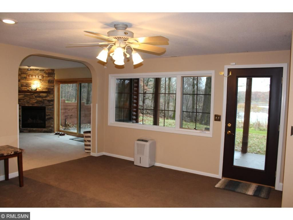 """Downstairs, there's a spacious """"sitting area"""" at the bottom of the stairs. Both bedrooms, the bathroom, and the laundry area are all accessed via this space. And there's an exterior door for patio and yard access!"""
