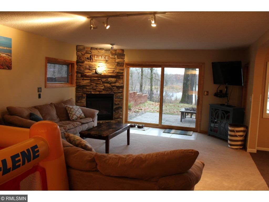 The lower level family room is boasts a corner gas fireplace and a huge 8-foot sliding glass door (new in 2016).