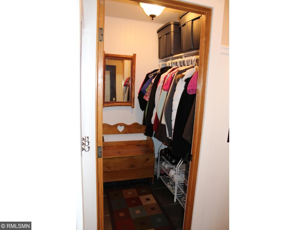 Just inside the foyer is a large walk in closet with a window and frosted-glass door. It lets in the light, gives you lots of space to put things, and still hides all your stuff!