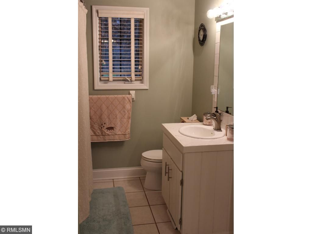 The main floor full bath is accessible through the foyer, and has a walk-through access to the main level bedroom. Perfect for your guests!