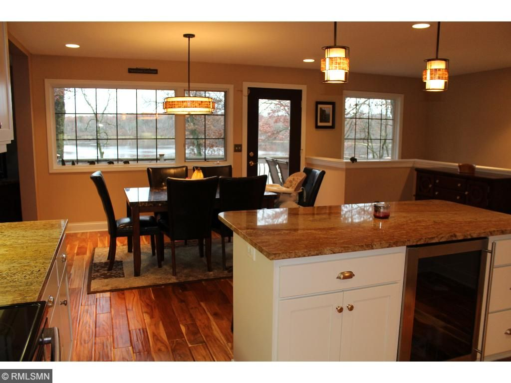 With a flowing open floor plan and plenty of windows, you won't be isolated in this kitchen! Granite counters, custom cabinets, and stainless steel appliances look good and work hard. Plus- WINE FRIDGE!