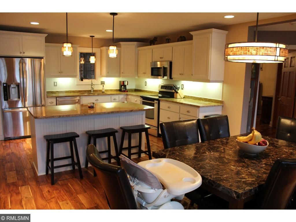 Lots of space for entertaining, and also perfect for family meals. Under cabinet lighting to make prep a breeze, and granite counters for easy clean up.