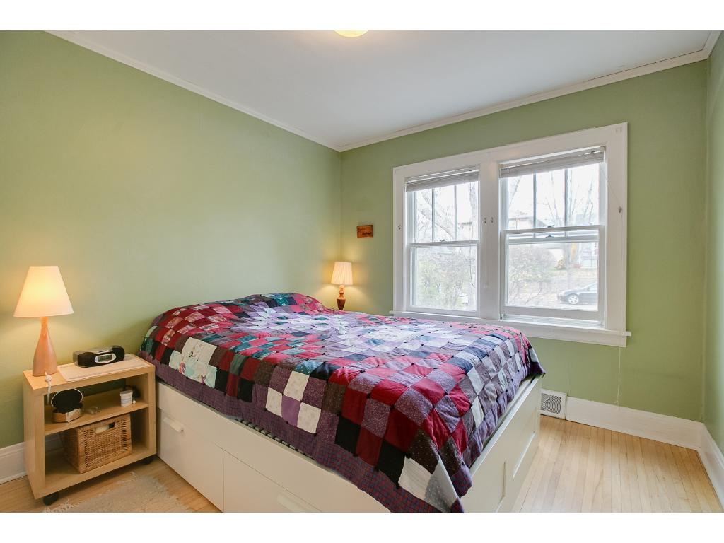 Charming main floor bedroom features ample closet storage and hardwood floors!