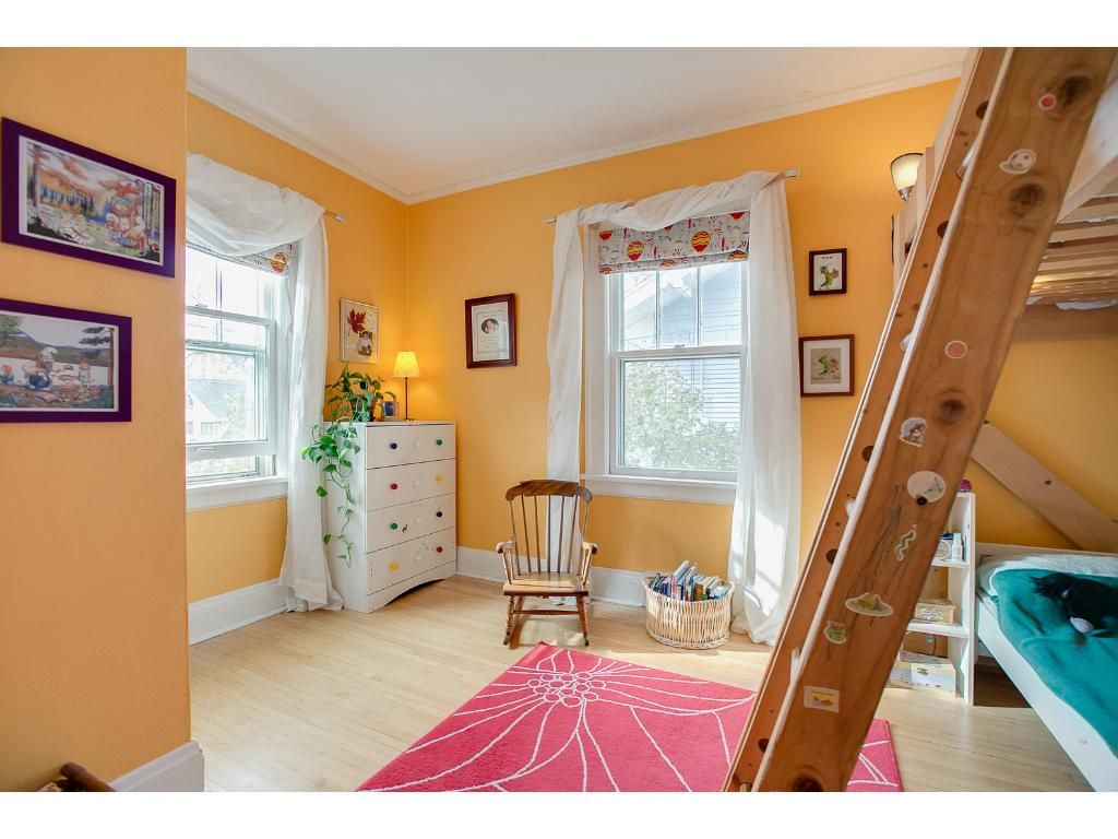 Another spacious main floor bedroom with gleaming hardwood floors!